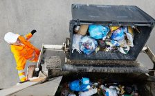 A dumpster is emptied into a garbage truck. File photo courtesy of © Can Stock Photo / kadmy.