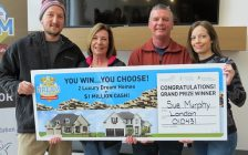 Sue Murphy and Dennis Reed (centre) and their two kids Jon Sweitzer and Erika Mercer hold the grand prize winner cheque for the fall edition of the Dream Lottery, December 5, 2019. (Photo by Miranda Chant, Blackburn News)