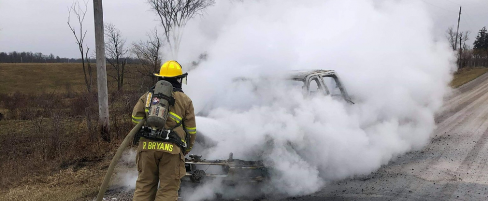 A firefighter dousing a fully involved pickup fire at Old Walnut Road and Oil Springs Line. January 14, 2019. (Photo by Brooke Fire via Twitter)