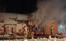 Firefighters battle a blaze at a townhouse on Kimberley Avenue in London, January 21, 2020. (Photo courtesy of the London Fire Department via Twitter)