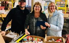 Doug Hunter (L) owner, Sons of Kent Brewing Company, Cindy Parry (M) from Outreach for Hunger and Alysson Storey, organizer of Holiday Jam for Hunger, with the financial donation to Chatham Outreach for Hunger. (Photo courtesy of Alysson Storey)