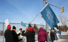 Members of the Ontario English Catholic Teachers Association picket outside of the Ford Engine Plant where Premier Ford was rumoured to be Tuesday, January 21, 2020. (Photo by Maureen Revait)