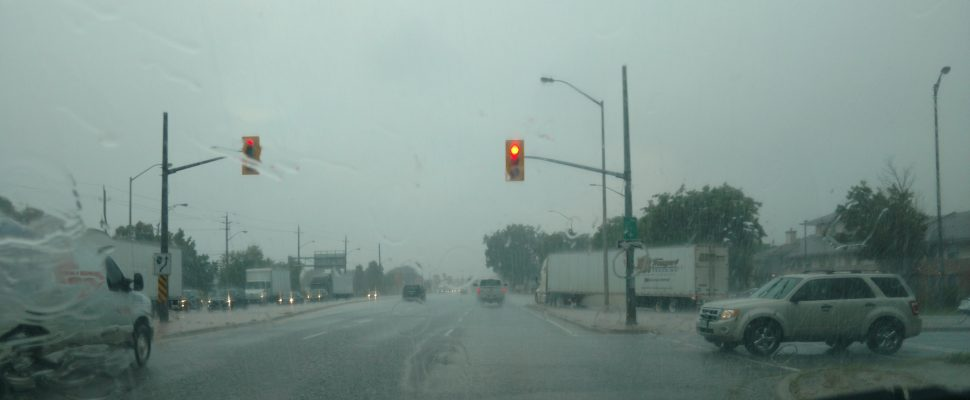 Vehicles driving in heavy rainfall. August 29, 2017. Photo by Mark Brown/Blackburn News.