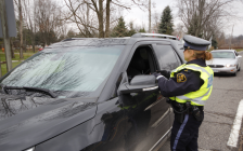 OPP officer checking for impaired drivers during the 2019 Festive RIDE Program. December 2019. (Photo by OPP West)