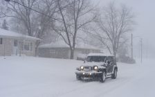 A Jeep driving through snowy conditions. December 19, 2008. (Photo by Michael Mol from Flickr)