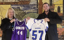 LuAnn Nickels and Ron Realesmith holding jerseys from St. Clair Secondary and Sarnia Collegiate. January 2020. (Photo provided by Ron Realesmith)