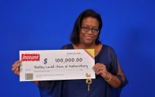 Shelley Lovell-Rees of Amherstburg shows off her $100,000 cheque at the OLG Prize Centre in Toronto, January 16, 2020. Photo provided by Ontario Lottery and Gaming.
