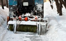 File photo of a sidewalk plow with a brush attachment courtest of © Can Stock Photo / reticent