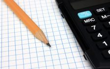 Black calculator and pencil on graph paper. © Can Stock Photo / berczy04