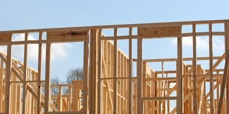 Wood framing in the early construction of an apartment complex. © Can Stock Photo / dbvirago
