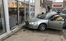A vehicle is seen against a damaged window at a Shoppers Drug Mart in Tecumseh, January 16, 2020. Photo provided by Tecumseh Fire/Twitter.
