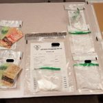 Drugs and currency seized in Petrolia. February 2020. (Photo by Lambton OPP)
