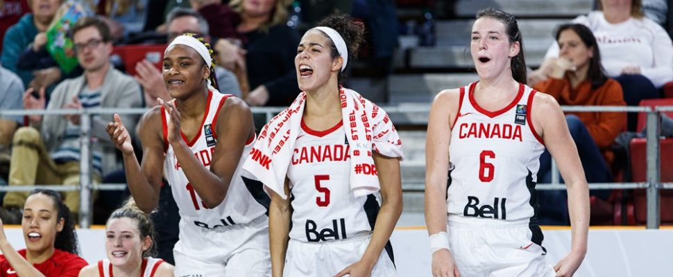 Bridget Carleton (far right) cheers on her teammates during a 2019 FIBA Olympic Pre-Qualifying Tournament in Edmonton. November 2019. (Photo courtesy of FIBA.)
