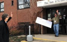 Rotarian Michael John Kooy surprises Inn of the Good Shepherd Executive Director Myles Vanni with a cheque from the Rotary Club of Sarnia for $4000 – while observing social distancing. March 2020. (Photo provided by the Rotary club)