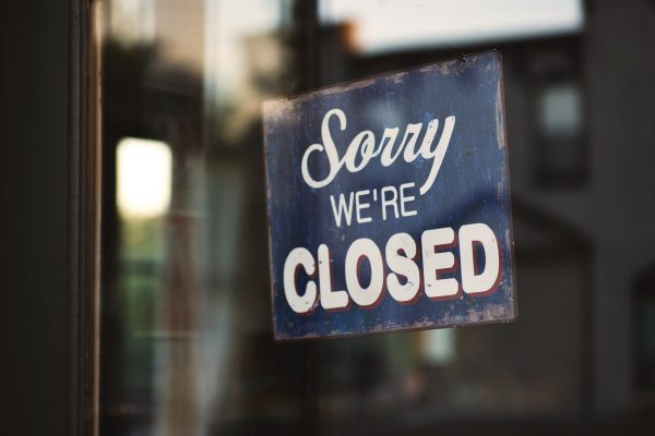 """Sorry We're Closed"" sign. (Photo by Tim Mossholder from Pexels)"