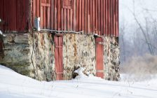 Close up of a red barn in winter. © Can Stock Photo / tfawls