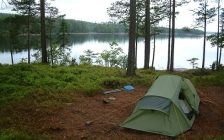 A tent setup along the water. File photo courtesy of © Can Stock Photo / snip