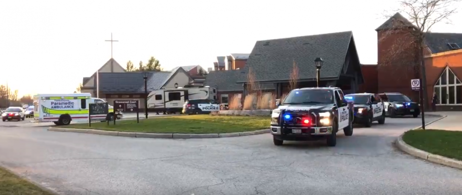 Stratford Police and Perth County EMS paying their Respects to the staff, loved ones and residents of Greenwood Court after the passing of a resident due to COVID-19. 11 April 2020. (Screenshot of video by PSD Jack on Twitter)
