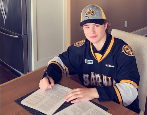 Max Namestnikov signing an Ontario Hockey League standard player agreement with the Sarnia Sting. April 2020. (Photo provided by Sarnia Sting Hockey Club)