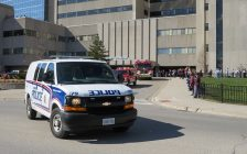 A convoy of London police, fire and EMS vehicles outside of University Hospital showing support to healthcare workers, April 1, 2020. (Photo by Miranda Chant, Blackburn News)