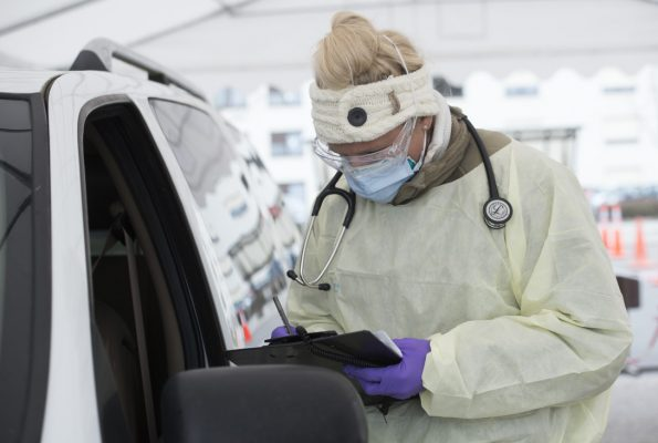 Staff Sgt. Maxime Copley writes down patient information in the Ramstein Medical Clinic's COVID-19 screening drive-thru at Ramstein Air Base, Germany, March 31, 2020. (U.S. Air Force photo by Airman 1st Class Taylor D. Slater)