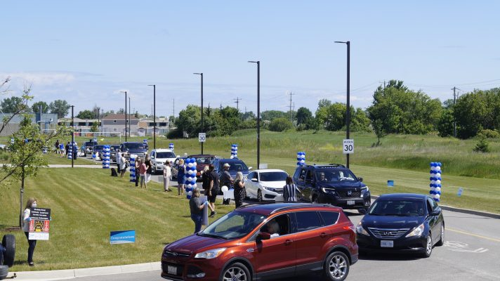 Students from Lambton College taking part in drive-by graduation parade at the Sarnia school. 24 June 2020. (BlackburnNews.com photo by Colin Gowdy)