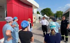 A group of Erie Shores Healthcare employees and Essex-Windsor EMS paramedics gather for a briefing before testing agri-food workers for COVID-19, June 2, 2020. Photo submitted by Kristin Kennedy/ESHC.