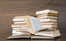 A stack of books sitting on a table. File photo courtesy of © Can Stock Photo / Pakhnyushchyy.