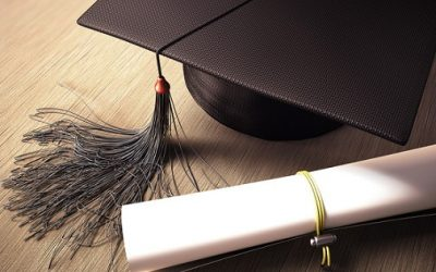 A graduation cap and diploma. File photo courtesy of © Can Stock Photo / iDesign.