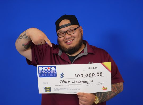 John Phan of Leamington picks up his $100,000 Encore cheque at the OLG Prize Centre in Toronto, July 6, 2020. Photo provided by OLG.