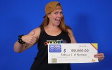 Rebecca Johnston of Alvinston with an Encore OLG cheque for $100,000. 4 July 2020. (Photo by OLG)