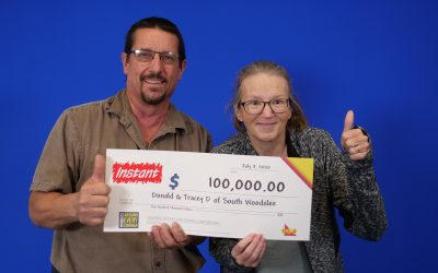 Donald and Tracey Dupuis of Lakeshore pick up their $100,000 cheque at the OLG Prize Centre in Toronto, July 7, 2020. Photo provided by OLG.