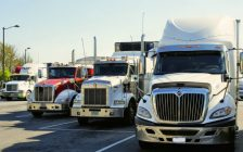 Transport trucks parked in a row. (Photo from Pxhere)