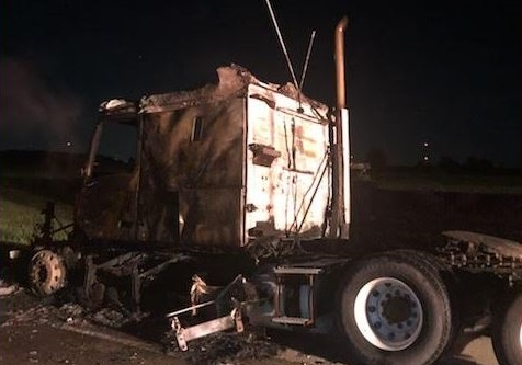 A tractor-trailer that caught fire on Hwy. 401 Friday, July 31 2020. (Photo courtesy of Ontario Provincial Police)