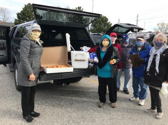 """Dianne Blonde Pinkerton joins members of the Victoria Ave. United Church Outreach Program for their Wednesday """"soup kitchen"""" program. (Photo courtesy of Marianne Johnstone)"""