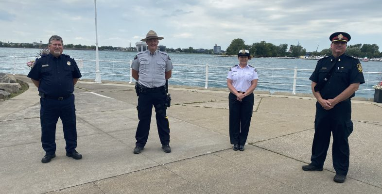 CBSA Operations Chief Rob Long, RCMP Cst. Ian Smith, Coast Guard Deputy Superintendent Kathleen Getty and Sarnia Police Deputy Chief Owen Lockhart discuss plans for the 2020 Port Huron Float Down. August 14, 2020 Photo by Melanie Irwin