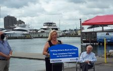 MPP Lisa MacLeod making a funding announcement at Andrew S. Brandt Marina at Sarnia Bay, with Brandt (right) and Sarnia-Lambton MPP Bob Bailey in the backdrop. 11 August 2020. (BlackburnNews.com photo by Colin Gowdy)