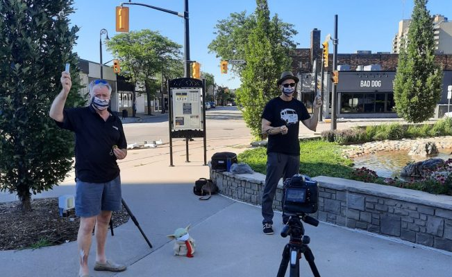 """Sarnia Mayor Mike Bradley (left) with Sarnia bluegrass musician Mike Stevens filming a music video for Stevens' latest record, """"Breathe In the World, Breathe Out Music"""", outside Sarnia City Hall. July 2020. (Photo from Bradley's Twitter)"""