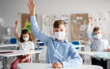 Students wearing face masks in the classroom. (© Can Stock Photo / halfpoint)