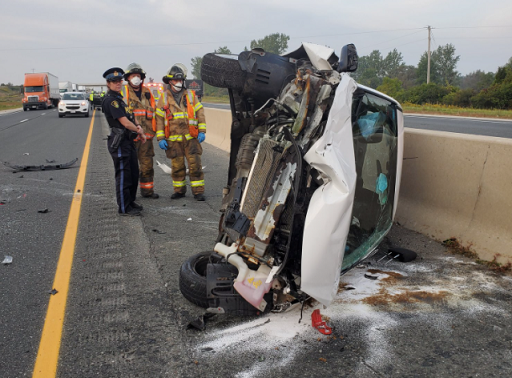 A vehicle rests on its side after a crash on Highway 401 east of Wonderland Rd., September 24, 2020. Photo courtesy of Middlesex OPP.