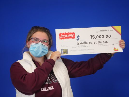 Isabella McKinlay of Oil City claims the top prize from an Instant Fruit Explosion ticket. September, 2020 Photo courtesy of OLG.