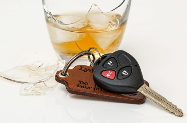 Car keys next to a broken glass of alcohol. (Photo from Pxhere)