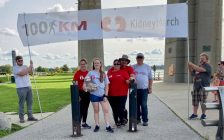 """(From left to right) Alaina, Abby, Kim and Paul Wright, and Kim's father, Wayne Freer, celebrate the family's Kidney March trek under the Blue Water Bridge. 13 September 2020. (Photo from """"Living on Love"""" Facebook page)."""
