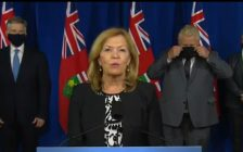 Ontario Minister of Health Christine Elliott speaks with reporters at Queens Park in Toronto, accompanied by Finance Minister Rod Phillips, left, Premier Doug Ford, and Dr. David Williams, Ontario's chief medical officer of health, September 28, 2020.. Photo courtesy YouTube/CPAC.