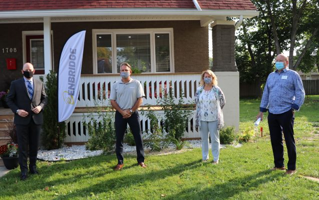 Windsor Mayor Drew Dilkens, left, at the home of Nick Bibic, right, announcing a partnership between the city and utility to help residents save energy costs. Photo courtesy Mayor Drew Dilkens/Twitter.