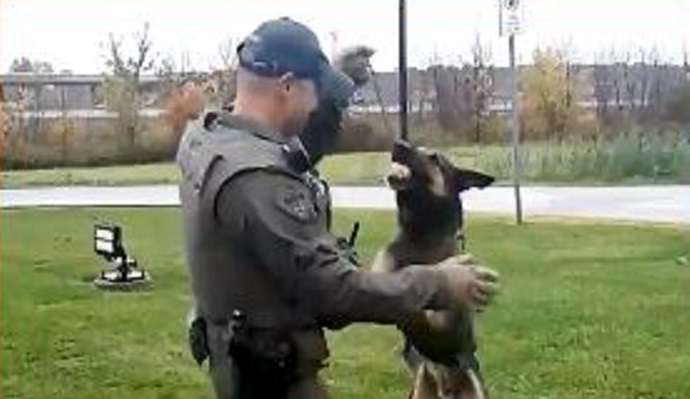A screen shot of Maximus and his handler Constable Milan Matovski from tribute video courtesy of Essex County OPP.