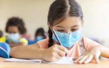 Children wearing face masks in school. (File photo courtesy of © Can Stock Photo / tomwang)