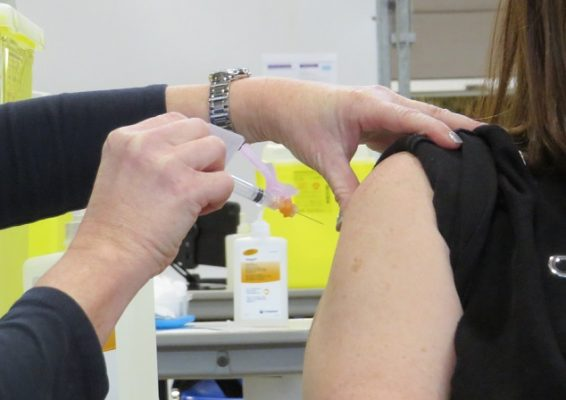 A public health nurse administers the COVID-19 vaccine. (File photo by Miranda Chant, Blackburn News)