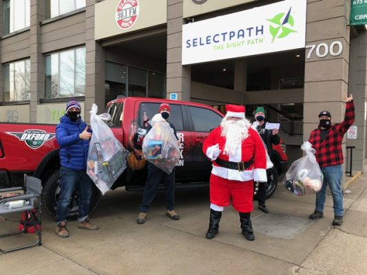 Blair and RV of Classic Rock Mornings, along with Santa himself, collect toys for the Salvation Army's Christmas hamper program, December 11, 2020. (Photo courtesy of Blair and RV)