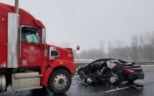 A collision between a car and a transport truck on the Highway 401 near London. 26 January 2021. (Photo by Middlesex OPP)